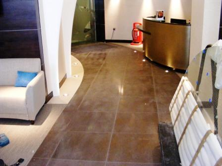 Cocoa Porcelain Tiled Reception Before Cleaning