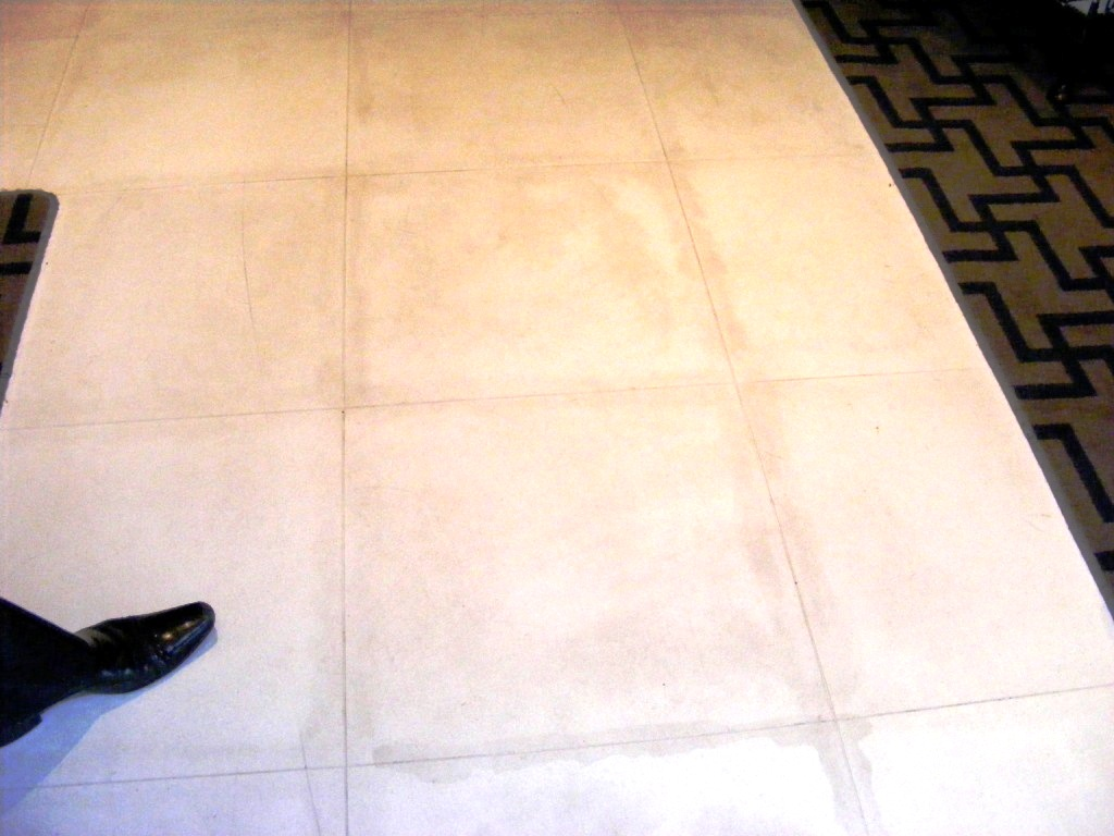 Badly Stained Limestone Floor Hotel Reception